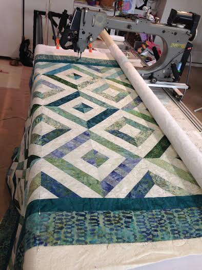 "Make a quilt ""sandwich"". I quilt on my Gammill long-arm machine"